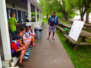 adult teaching sailing class