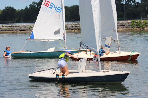 child learning how to sail