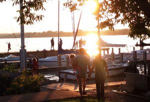 family walking toward dock