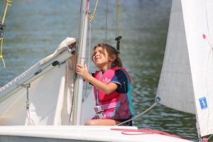 child working a sail