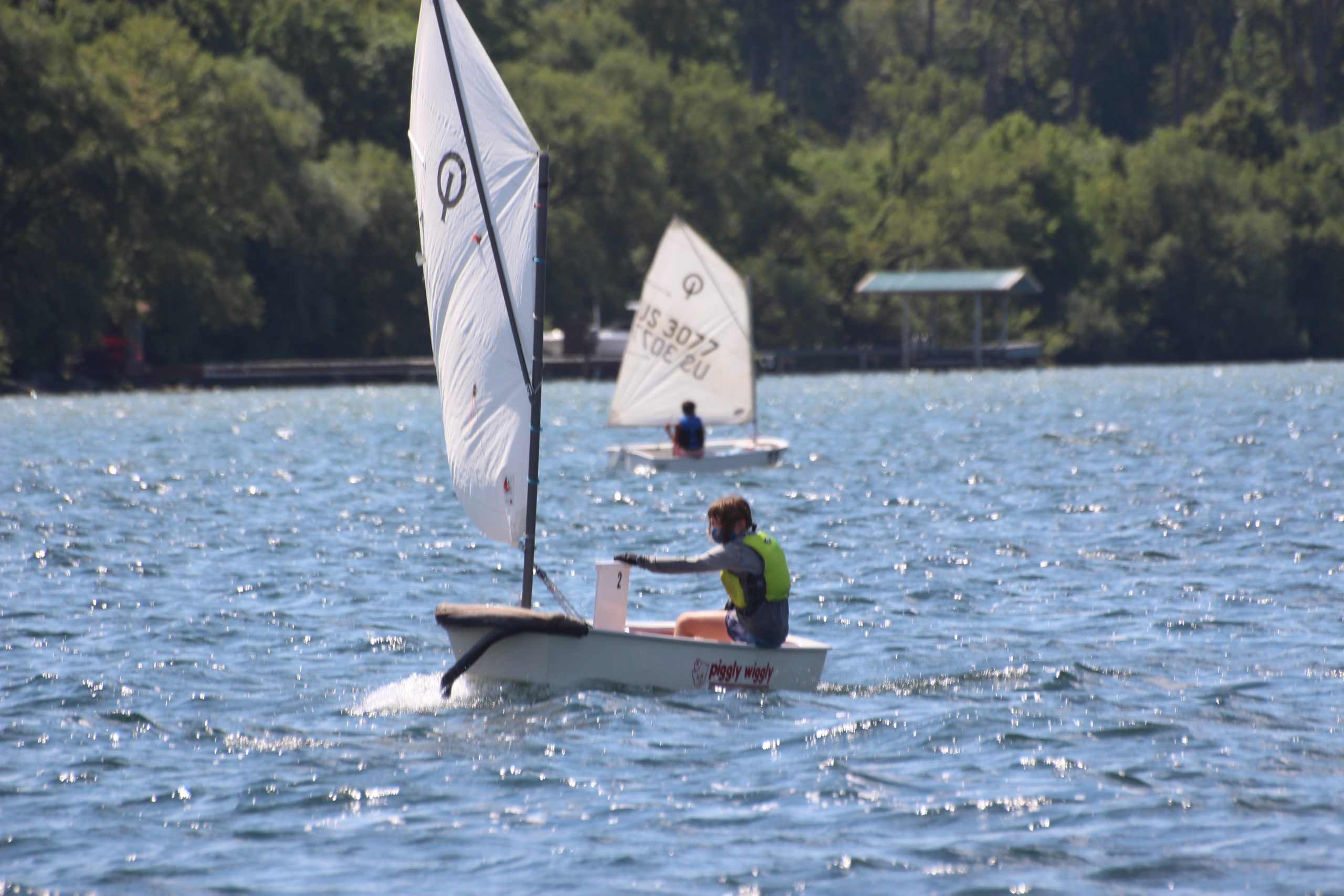 Optimist Prams sailing dinghys on the water.